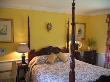 The Byre Suite - Bedroom with mahogany four-poster bed - larger image