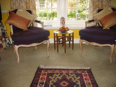 The Dovecote - Armchairs by the window, looking out onto the garden - larger image